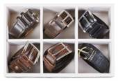 Top view of storage box with leather belts — Stock Photo