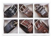 Leather belts in wooden storage box — 图库照片