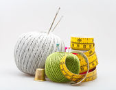 Few sewing objects on gray — Stock Photo
