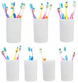 Collection of tooth brushes in ceramic glases — Stock Photo