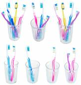Collection of toothbrushes in glases isolated — Stock Photo