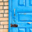 Details of closed shabby blue wooden door — Stock Photo #65148529