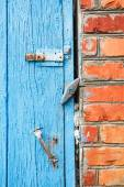 Blue painted wooden door with latches — Stock Photo