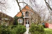 Front view of village cottage in spring — Stock Photo