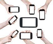 Set of children hands with smart phones isolated — 图库照片