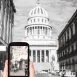 Tourist taking photo of El Capitolio, Havana — Stock Photo #66837355