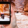 Taking photo of carriage in Siq passage to Petra — Stock Photo #66837457