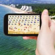 Tourist taking photo aerial view of Albena beach — Stock Photo #66837521