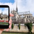 Taking photo of Notre Dame Paris and tourist boat — Stock Photo #66839273