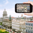 Tourist taking photo center old Havana — Stock Photo #66840635