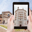Tourist taking photo of Baptistery in Parma — Stock Photo #66840739