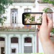 Tourist taking photo of old building in Havana — Stock Photo #66841195