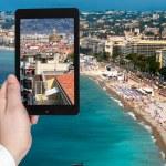 Tourist taking photo of Nice city on Azure coast — Stock Photo #66841275