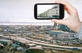 Tourist taking photo of Anadyr town skyline — Stock Photo