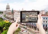 Tourist taking photo of center Havana city — Stock Photo