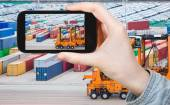 Tourist taking photo of freight containers in port — Stock Photo