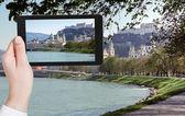 Tourist taking photo of Salzach River and Salzburg — Stock Photo