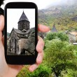 Tourist photographs geghard monastery in Armenia — Stock Photo #67990265
