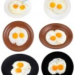 Set from two fried eggs on plates isolated — Stock Photo #67990827