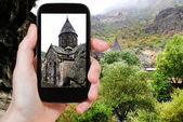 Tourist photographs geghard monastery in Armenia — Stock Photo