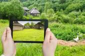 Tourist photographs of backyard in village — Stock Photo