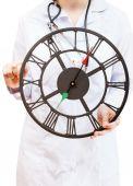 Nurse holds big clock — Foto de Stock
