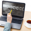 Medic analyzes X-ray picture of spine on laptop — Stock Photo #70201755