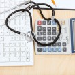 Stethoscope on keyboard, calculator and clipboard — Stock Photo #70203239