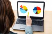 Laptop with chart on screen on office table — Stock Photo