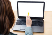 Laptop with isolated screen on office desk — Stock Photo