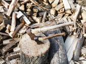 Pile of wood, deck for chopping firewood, two axes — Stock Photo