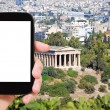 Tourist photographs Temple of Hephaestus in Athens — Stock Photo #73144657