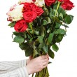 Two hands giving bunch of various roses isolated — Stock Photo #74168307