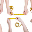 Set of female hands with measuring tapes — Stock Photo #75184255