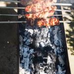 Kebab sticks on outdoor grill — Stock Photo #78018212