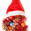 Christmas decorations spill over red santa hat — Stock Photo #78073396
