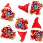 Set of red santa hats with xmas decorations — Stock Photo #78073624