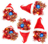 Set of red santa hats with xmas decorations — Stock Photo