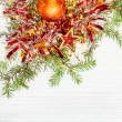 Star and two orange Xmas baubles and twig on paper — Stock Photo #78296106