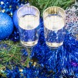 Two glasses with blue Xmas decorations and tree 5 — Stock Photo #78295892