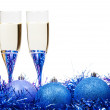 Two glasses of champagne at blue and violet tinsel — Stock Photo #78295914