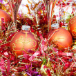 Range Xmas balls and red tinsel with two glasses — Stock Photo #78296030