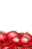 Five red Xmas balls and tinsel isolated — Stock Photo