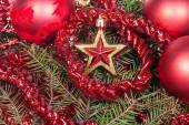 Red star, decoration on Christmas tree background — Stock Photo