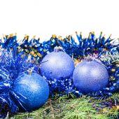 Blue Christmas balls on green fir tree branch — Stock Photo
