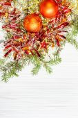Star and two orange Xmas baubles and twig on paper — Stock Photo