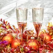 Glasses of sparkling wine with gold Xmas baubles — Stock Photo #78834008