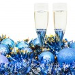Glasses of wine and blue Xmas balls and tinsel — Stock Photo #78834030