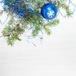 One blue Xmas ball and tree branch on blank paper — Stock Photo #78834084