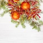 Three orange Xmas balls and twig on blank paper — Stock Photo #78834088